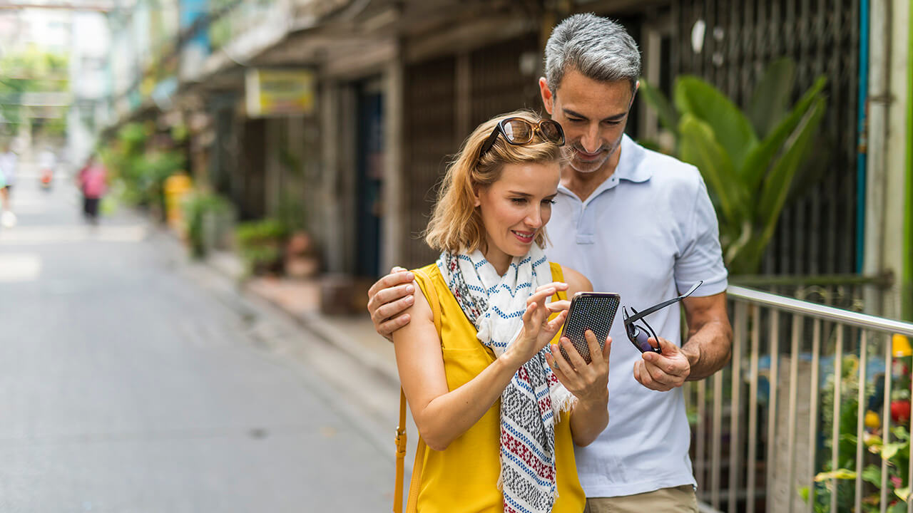 couple using a phone to get directions identity verification news