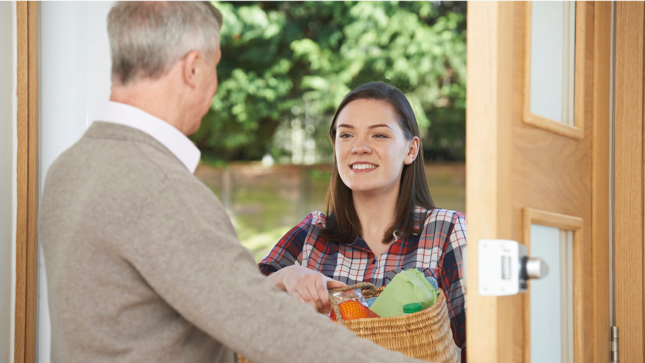 identity verification news teenager delivering groceries to elderly person